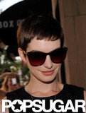 Anne Hathaway donned a pair of sunglasses as she arrived at the Shut Up & Play the Hits screening in NYC.