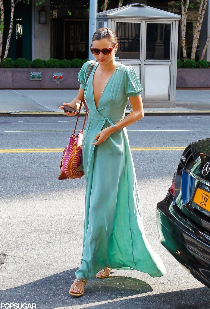 Miranda Kerr wore her hair pulled back.