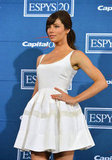 Jessica Biel added color to her all white ensemble with bright orange polish.
