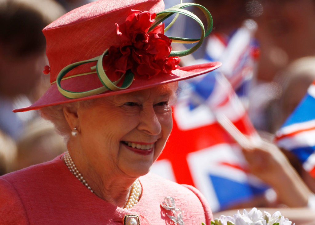 The queen wore a vibrant hat and coat during her Diamond Jubilee visit to Birmingham.