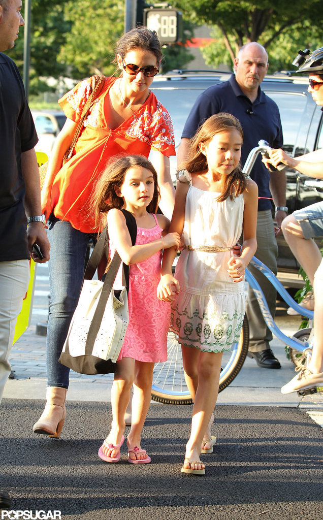 Suri Cruise clutched her friends arm.