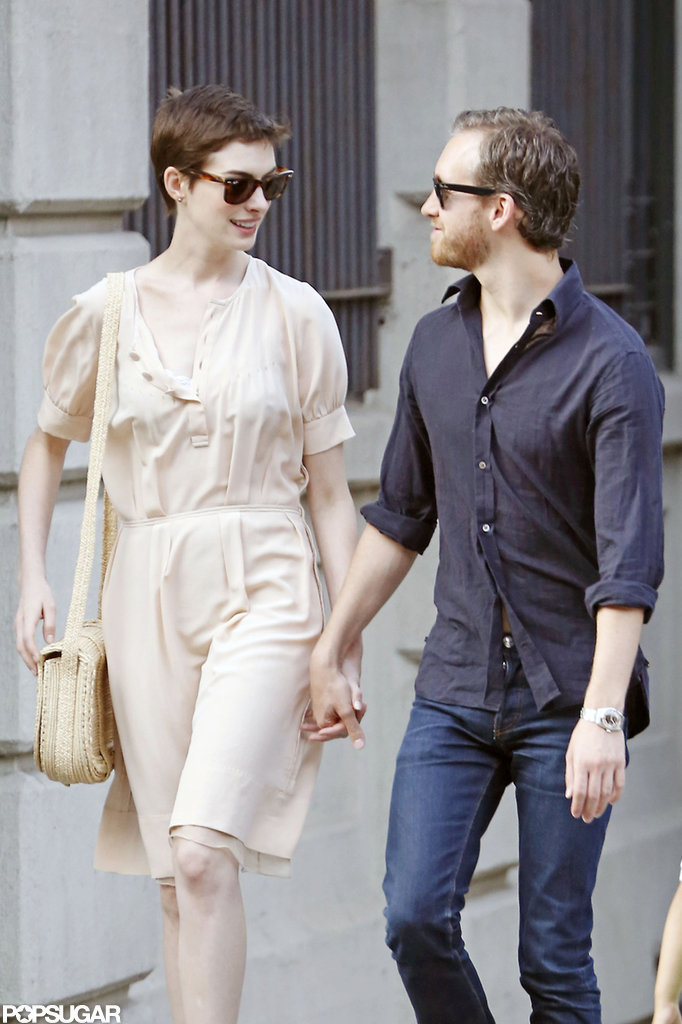 Anne Hathaway and Adam Shulman held hands.