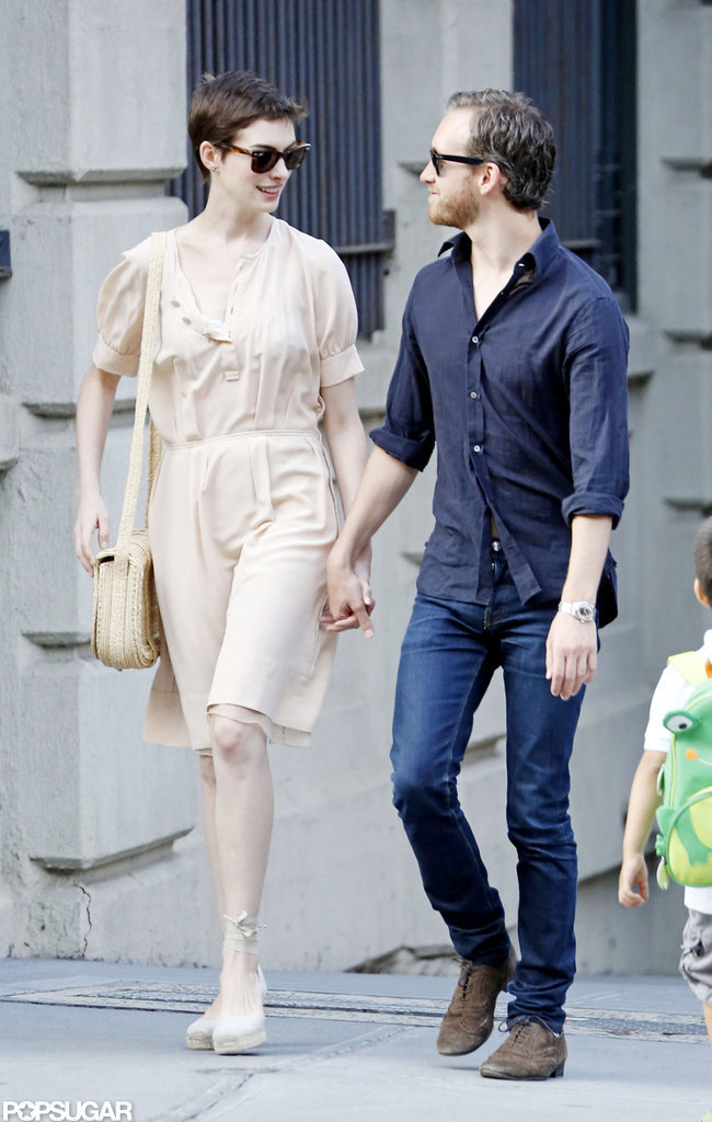 Anne Hathaway held hands with her fiancé.