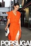 Katie Holmes wore a bright dress.
