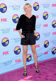 Portia de Rossi paired a black top with navy shorts and sexy strappy sandals.
