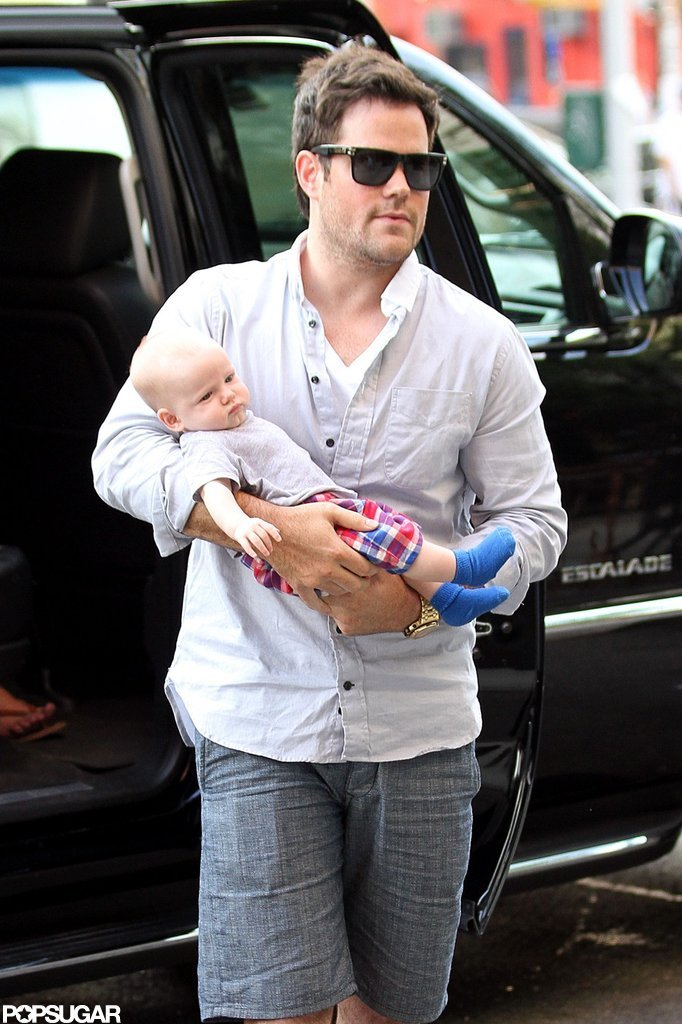 Mike Comrie hopped out of a car in NYC with baby Luca Comrie in his arms.