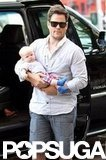 Mike Comrie carried an adorable baby Luca Comrie in NYC.