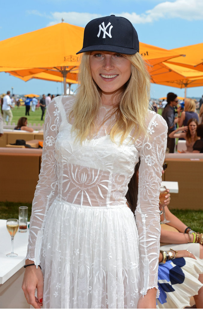 Dree Hemingway repped the NY Yankees by pairing a sleek logo cap with a lacy white dress at the Veuve Clicquot Polo Classic.