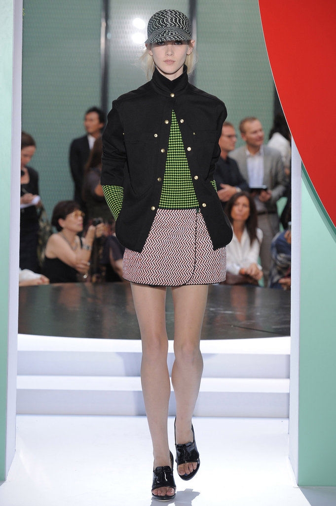 At Kenzo's Spring 2012 show, models hit the runway in sporty caps paired with skirts and dresses.