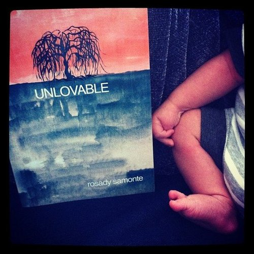 Rainlab was reading Unlovable by Rosady Samonte with a loveable baby.