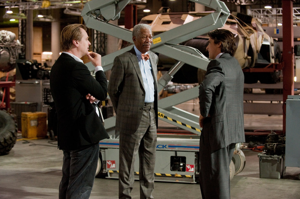 Christopher Nolan, Morgan Freeman, and Christian Bale on the set of The Dark Knight Rises.  Photo courtesy of Warner Bros.