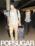 Liam Hemsworth carried bags for Miley Cyrus.