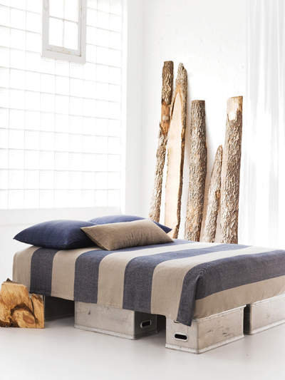 Pine Cone Hill's Cotton Twill Oatmeal Ink Blanket ($115 for queen) features majorly wide stripes and subdued colors.