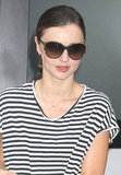 Miranda Kerr kicked off her morning in dark shades.