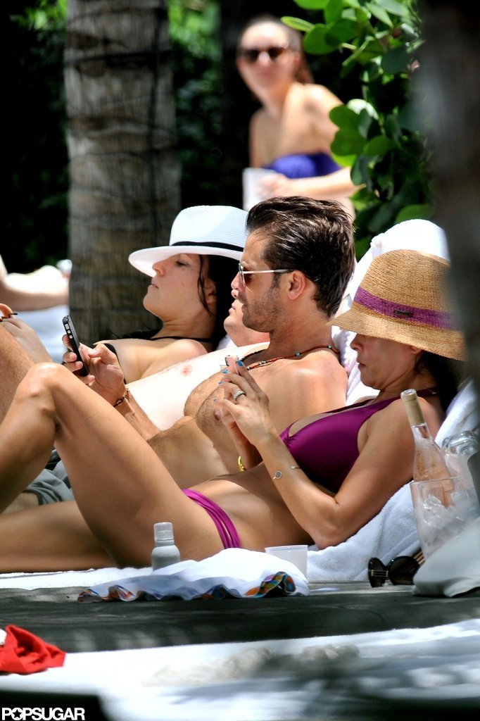 Brooke Burke relaxed with a shirtless David Charvet.