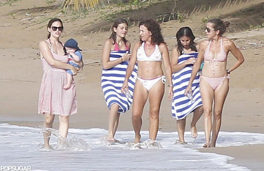 Jennifer Garner took a beach walk with friends while carrying Samuel Affleck.
