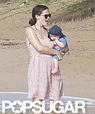 Jennifer Garner wore a red and white striped dress while carrying Samuel dressed in a blue hat.