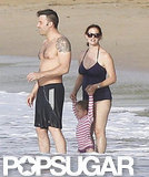 A shirtless Ben Affleck showed off his tattoos while taking a dip in the water with Jennifer Garner and Seraphina Affleck.