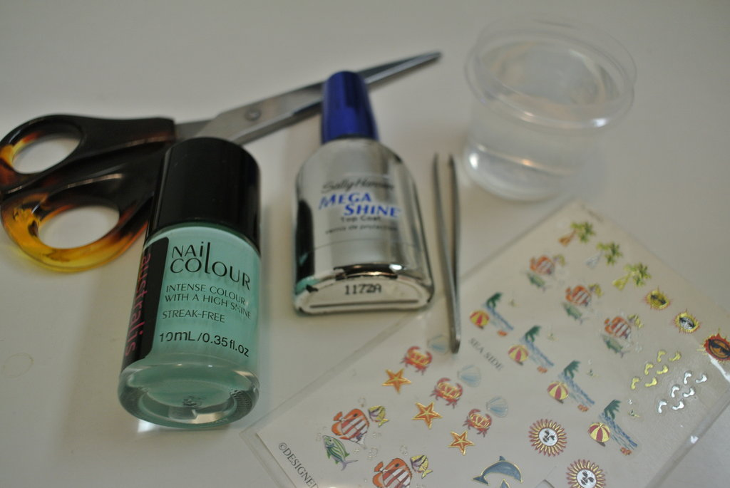 Everything you'll need:  Scissors Water Tweezers Water decals Nail polish