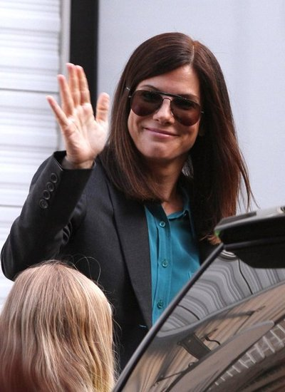 Sandra Bullock smiled and waved.