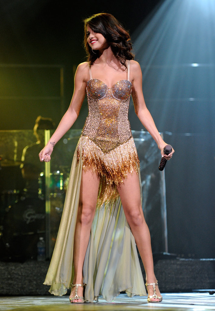 Selena took to the stage in a showgirl-style corset and train during a performance in Las Vegas in 2011.