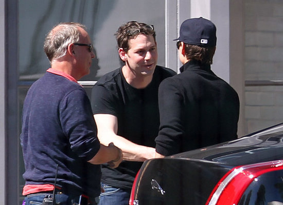 Tom Cruise shook hands with a man in London.