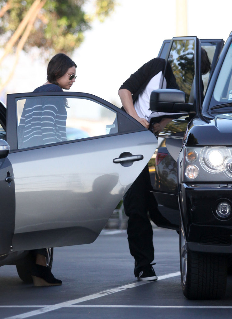 Mila Kunis met up with Ashton Kutcher in LA to see The Dark Knight Rises.