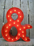 Aside from providing a beautiful glow, carnival lights can add an element of kitsch and fun to wedding decor. Instead of searching for the right initials, consider using something like this Painted Marquee Ampersand ($150). After the wedding, just incorporate it into a gallery wall of art.