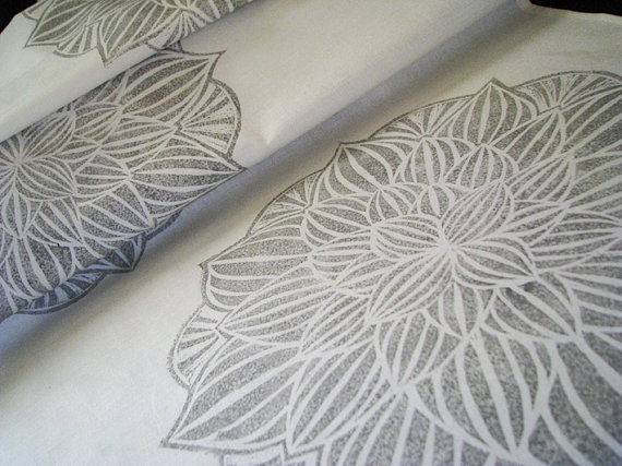 Consider using your wedding table runner or runners for other purposes after the wedding. We like the idea of cutting and sewing this Gray Floral Table Linen Runner ($23) into pillows or tea towels.