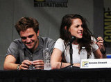 Robert Pattinson stayed close to Kristen Stewart as the two spoke to Comic-Con attendees at a panel for Breaking Dawn Part 2 in 2012.