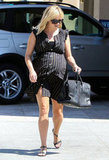 Reese Witherspoon showed off her baby bump for lunch in LA.