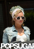 Demi Lovato wore white sunglasses.