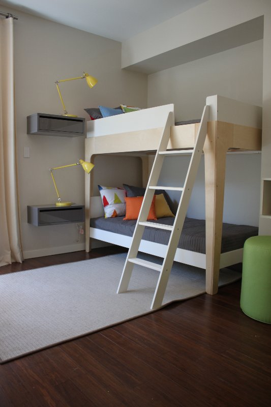 Perch bunk beds, picked up from Aldea Home, complement the clean lines of the children's room.