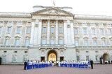 Children joined Prince William, Kate Middleton, and Prince Harry at Buckingham Palace to greet the Olympic flame.