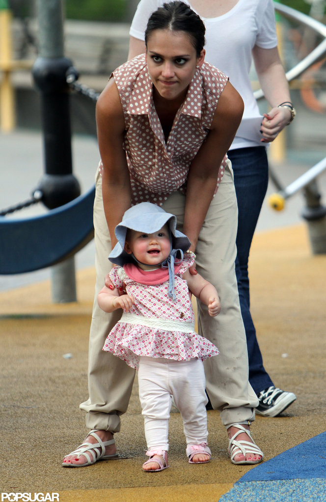 Haven laughed while Jessica Alba helped her walk around the playground in NYC.