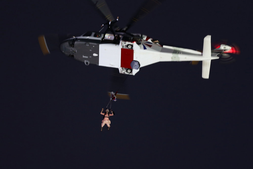 Daniel Craig accompanied a stunt person dressed as the queen for their arrival by helicopter.