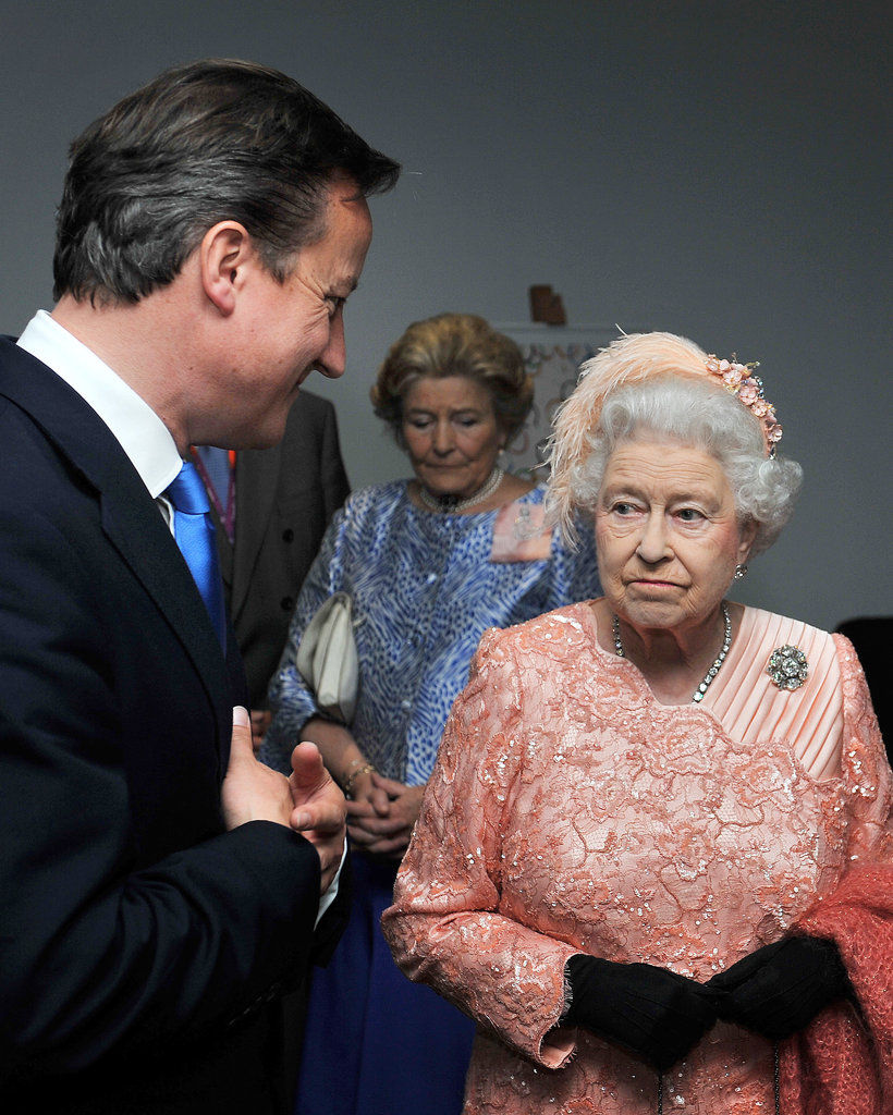 The prime minister chatted with the queen.