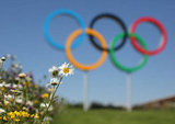 The Olympic rings stood beside flowers at the Olympic Park.