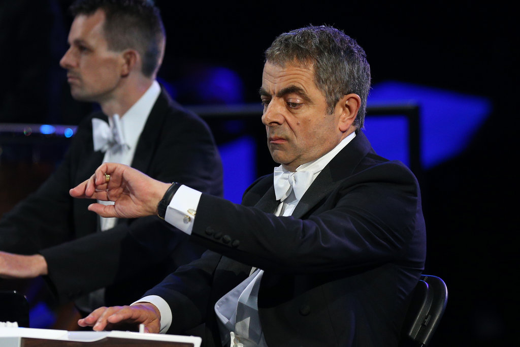 Rowan Atkinson as Mr. Bean checked his watch.