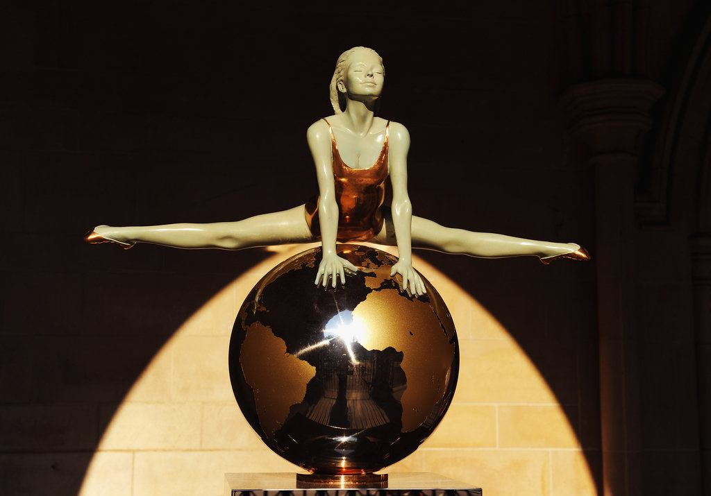 A gymnast sculpture stands at the front of St. Margaret's Church in Westminster Abbey.