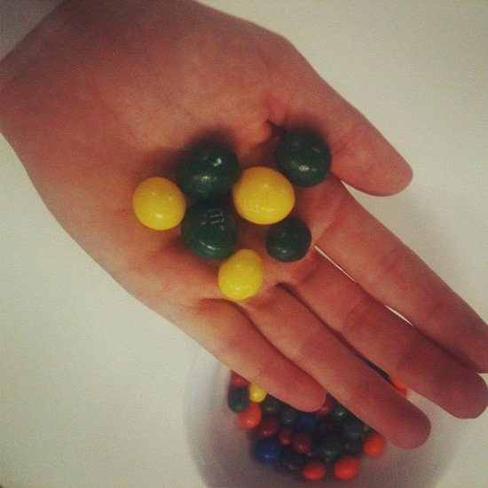 We'll support green and gold in whatever way we can... even if it means eating endless amounts of M&M's.