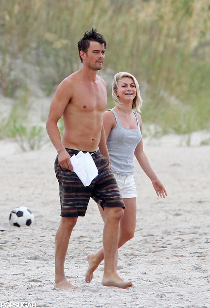 Julianne Hough and Josh Duhamel walked side by side on the beach.