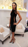 Joan Smalls showed just the bare minimum of skin via a side slit in her sexy LBD. To finish off the nighttime look at Omega's party, she wore crisscross pumps and slicked-back hair.