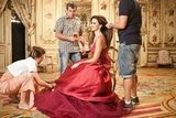 Penélope Cruz looked gorgeous in a red gown while shooting Campari's 2013 calendar.
