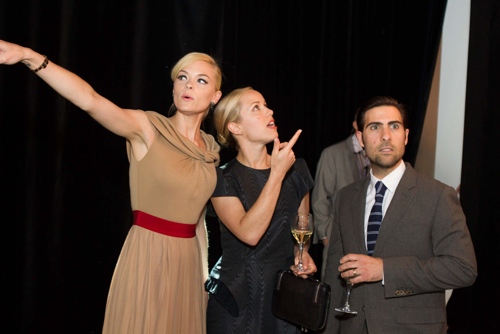 Jaime King, Brady Cunningham, and Jason Schwartzman struck funny poses at the Lexus art exhibit.