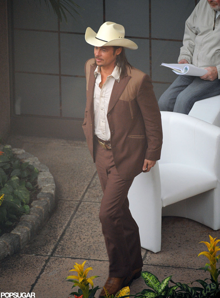 Brad Pitt rocked a cowboy hat while filming.