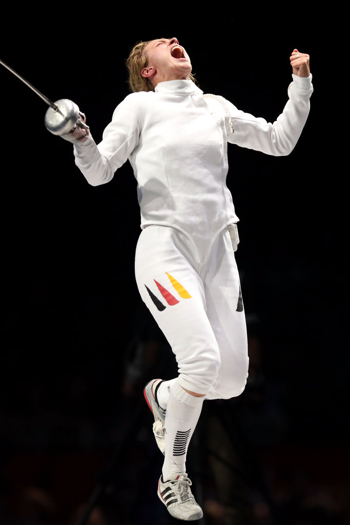 Britta Heidemann of Germany showed excitement after winning in the fencing semifinals.