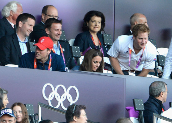 Kate Middleton Cuddles Up With William as They Watch Track With Harry