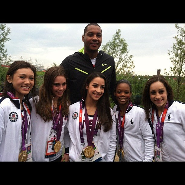 The US women's gymnastics team posed with Carmelo Anthony and their gold medals.  Source: Twitter user gabrielledoug