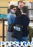 Anne Hathaway went through security with Adam Shulman.